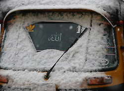 November 3, 2018 - Srinagar, Jammu and Kashmir, India - An auto rickshaw driver wipes the windshield during the season's first snowfall. Authorities have suspended vehicular traffic on Srinagar-Jammu National Highway, and some air traffic was also cancelled, the officials said. (Credit Image: © Faisal Khan/ZUMA Wire)