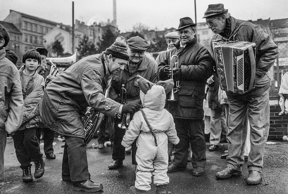 A group of musicians  talking to a child during the celebration of 115 years of Zizkov.