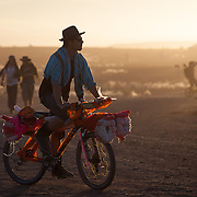 Man on a bicycle at AfrikaBurn 2014, Tankwa Karoo desert, South Africa