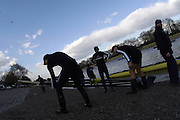 PUTNEY, LONDON, ENGLAND, 05.03.2006, Oxford prepare to boat, Pre 2006 Boat Race Fixtures,.   © Peter Spurrier/Intersport-images.com..OUBC, Bow Robin Esjmond-Frey, No.2 Colin Smith, No.3 Jake Wetzel, No.4 Paul Daniels, No.5 James Schroeder. No.6 Barney Williams, No. 7 Tom Parker, stroke Bastien Ripoll, and cox Nick Brodie,..[Mandatory Credit Peter Spurrier/ Intersport Images] Varsity Boat Race, Rowing Course: River Thames, Championship course, Putney to Mortlake 4.25 Miles Sunrise, Sunsets, Silhouettes