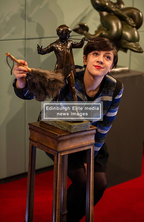Pictured: Hannah Willetts, a Lyon and Turnbull specialist, was on hand to ensure the sculpture was looking it's best ahead of the auction.<br /> <br /> A model of Sir George Frampton's bronze sculpture of J.M. Barrie's Peter Pan,  valued between £20,000 and £30,000 , will go up for auction by Lyon and Turnbull, Edinburgh, on 6 April.<br /> <br /> Ger Harley | EEm 3 April 2016