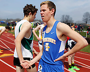 Britt Kaukeinen of Irondequoit, right, shakes hands with Rush-Henrietta's Ryan Yuhas at the His and Her track and field invitational at Penfield High School on Saturday, April 26, 2014.