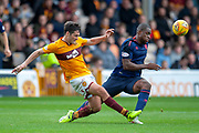 Carl McHugh (#4) of Motherwell FC clears the ball from Uche Ikpeazu (#19) of Heart of Midlothian during the Ladbrokes Scottish Premiership match between Motherwell and Heart of Midlothian at Fir Park, Motherwell, Scotland on 15 September 2018.