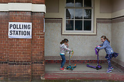 Children and their scooters outside their local polling station on the morning of the UK 2017 general elections outside St. Saviour's Parish Hall in Herne Hill, Lambeth, on 8th June 2017, in London, England.