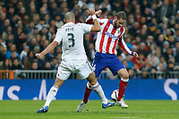 Real Madrid´s Pepe (L) and Atletico de Madrid´s Mario Suarez during Spanish King´s Cup match at Santiago Bernabeu stadium in Madrid, Spain. January 15, 2015. (ALTERPHOTOS/Victor Blanco)