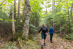 Two women hiking on Clare's Lodge to Lodge Trail near the Appalachian Mountain Club's Little Lyford Lodge in Maine's 100 Mile WIlderness.