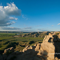 a man looks over the missouri river breaks national monument from high atop a rock outcropping, umrbnm, near judith landing on the wild and senic missouri river, russel country, montana, usa, russell