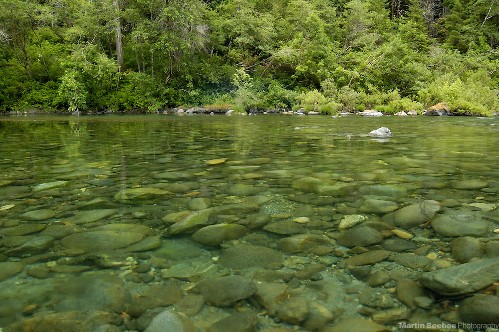 River rocks are easily seen through the crystal clear water of the Smith River, Smith River National Recreation Area, Six Rivers National Forest, California