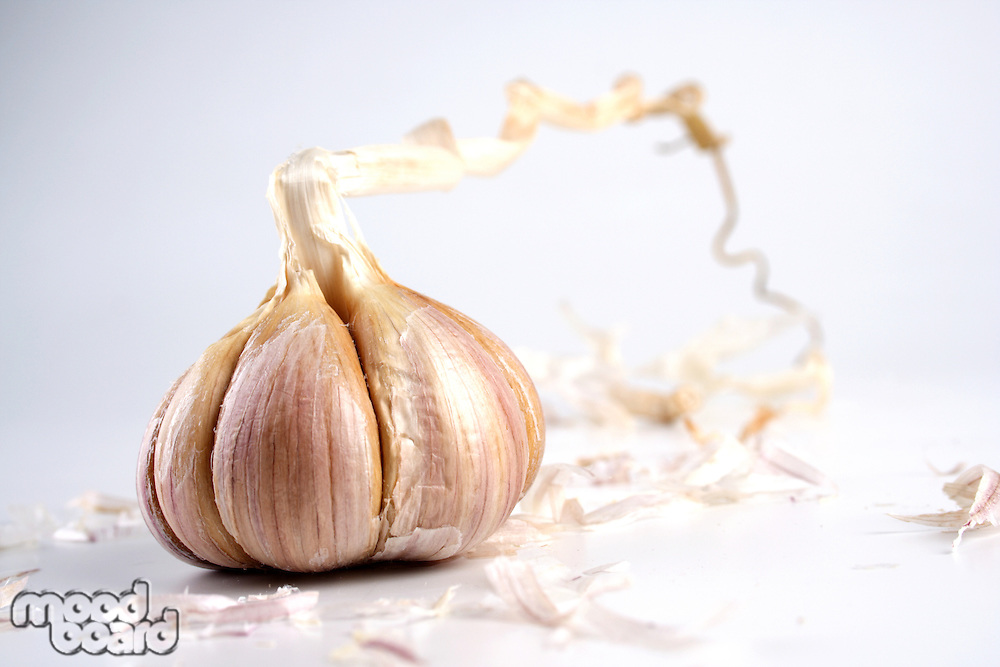 Close-up of garlic on white background