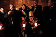 Roma 27 Gennaio 2010.Giornata della Memoria.Fiaccolata in ricordo perenne degli Stermini dimenticati dei Rom/Sinti, degli omosessuali, dei disabili. Da Piazza dell'Esquilino, fino alla Lapide sul Porrajmos e la Shoah, in Via degli Zingari 54.Nella Foto: Massimo Converso, Presidente dell'Opera Nomadi interviene in ricordo del Porrajmos,  partecipa anche il Sindaco di Roma Gianni Alemanno.<br /> Rome, January 27, 2010.Memorial Day.Candlelight vigil in memory perennial forgotten extermination of the Roma / Sinti, homosexuals, disabled. Piazza Esquilino, to the plaque on Porrajmos and the Holocaust, in Via degli Zingari 54.Pictured: Massimo Converso, president of Opera Nomadi intervenes in memory of Porrajmos,participates, the Mayor of Rome Gianni Alemanno.
