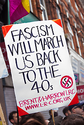 """Cricklewood, London, July 19th 2014. An anti-fascist counter-protester's poster delivers a stark warning as anti-Islamist activists from the """"South East Alliance"""" demonstrate outside the Cricklewood offices of Egypt's Muslim Brotherhood."""