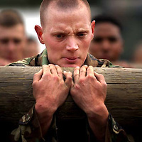 A Special Forces hopeful holds onto an 800 pound log during the selection process. mbfso Special Forces