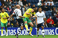 Preston - Saturday September 18th, 2010: Grant Holt of Norwich and Wayne Brown of Preston in action during the Npower Championship match at Deepdale, Preston. (Pic by Paul Chesterton/Focus Images)