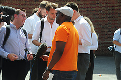 © Licensed to London News Pictures. 07/08/2018<br /> DEPTFORD, UK.<br /> (orange top)John Urhie father of Joel Urhie age 7 who died in the fire talked to reporters .<br /> 7 year old boy found dead after suspicious house fire at Adolphus Street, Deptford.   Arson investigation has been launched.<br /> Photo credit: Grant Falvey/LNP