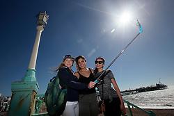 UK ENGLAND BRIGHTON 8SEP16 - Emirates cabin crew Sandra Czubak (26) of Poland (with hat), Denise Cetinkava (34, C) of Australia and Kanysmai Abasbekova (23) of Kirgyst take a selfie at the Brighton beach front.<br /> <br /> jre/Photo by Jiri Rezac<br /> <br /> © Jiri Rezac 2016