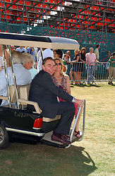 LORD & LADY LLOYD-WEBBER at the Cartier International polo at Guards Polo Club, Windsor Great Park, on 30th July 2006.<br />