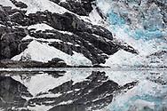 Reflection of Cascade Glacier in Harriman Fjord in Southcentral Alaska. Summer. Morning.