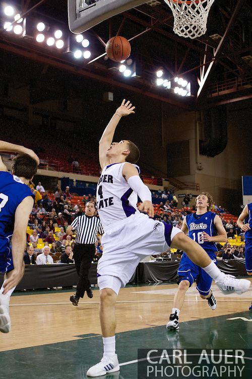 November 27th, 2010:  Anchorage, Alaska - Weber State sophomore Scott Bamforth (4) is fouled on a shot in the Wildcat 82-81third place game victory over the Drake Bulldogs at the Great Alaska Shootout.