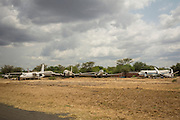 Derelict planes sit beside the runway in Lokichogio, Kenya. The closest airport to South Sudan, Lokichogio was once a major hub for NGO aid to war-torn Sudan, but since the South's independence it's importance has dwindled.