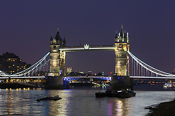 © Licensed to London News Pictures. 23/03/2016. London, UK. Tower Bridge is illuminated in yellow, one of the colours of the Belgian tricolor flag this evening, in a tribute to victims of the Belgium terrorist attacks which took place yesterday. Landmarks across London are paying tribute this evening. Photo credit : Vickie Flores/LNP