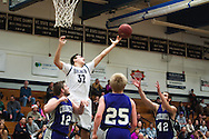Burlington's Almir Konjohovac (32) leaps to try and grab the rebound during the boys basketball game between Brattleboro and Burlington at Burlington High School on Saturday afternoon December 19, 2015 in Burlington. (BRIAN JENKINS/for the FREE PRESS)