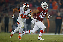 PALO ALTO, CA - NOVEMBER 10:  Running back Cameron Scarlett #22 of the Stanford Cardinal rushes up field for a touchdown past linebacker Andrzej Hughes-Murray #49 of the Oregon State Beavers during the third quarter at Stanford Stadium on November 10, 2018 in Palo Alto, California. The Stanford Cardinal defeated the Oregon State Beavers 48-17. (Photo by Jason O. Watson/Getty Images) *** Local Caption *** Cameron Scarlett; Andrzej Hughes-Murray