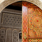 Ornate painted door and archway on Kairaouine Mosque in the medina in Fez. The mosque was built in the 9th century AD and is considered the most important in Morocco.