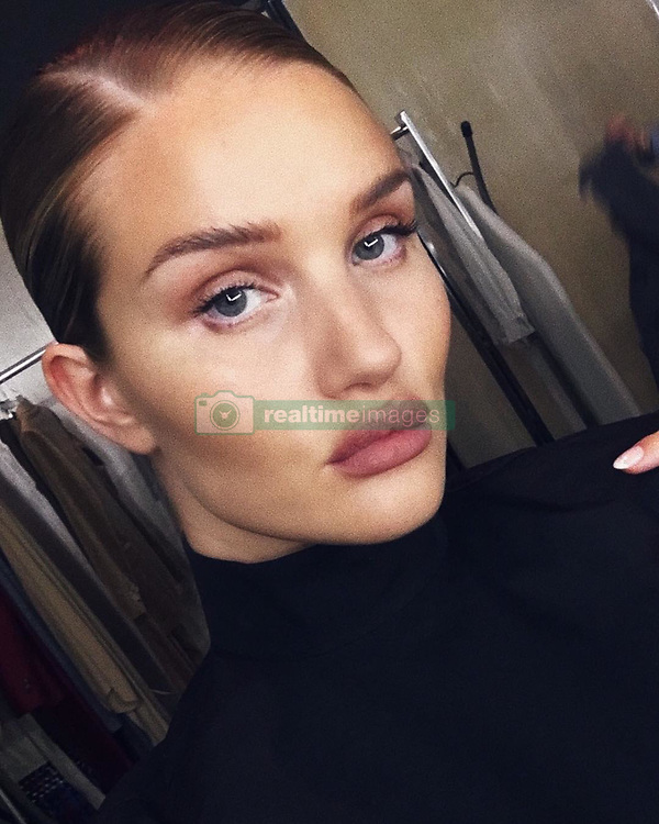 "Rosie Huntington-Whiteley releases a photo on Instagram with the following caption: ""sleek glam"". Photo Credit: Instagram *** No USA Distribution *** For Editorial Use Only *** Not to be Published in Books or Photo Books ***  Please note: Fees charged by the agency are for the agency's services only, and do not, nor are they intended to, convey to the user any ownership of Copyright or License in the material. The agency does not claim any ownership including but not limited to Copyright or License in the attached material. By publishing this material you expressly agree to indemnify and to hold the agency and its directors, shareholders and employees harmless from any loss, claims, damages, demands, expenses (including legal fees), or any causes of action or allegation against the agency arising out of or connected in any way with publication of the material."
