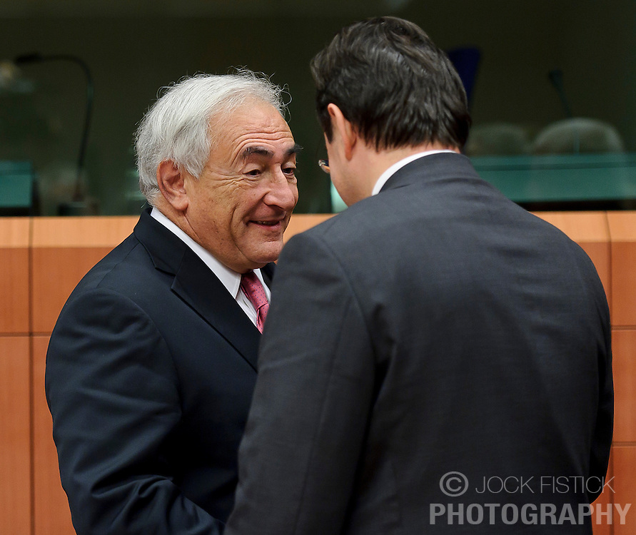 Dominique Strauss-Kahn, managing director of the IMF, left, speaks George Papaconstantinou, Greece's finance minister, during a meeting of the Euro-zone finance ministers at the EU Council headquarters in Brussels, Monday, Dec. 6, 2010. (Photo © Jock Fistick)
