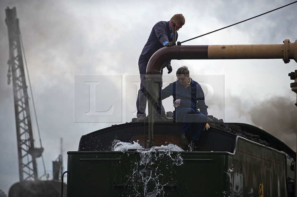 © under license to London News Pictures. 02/04/2011. The King Edward II steam locomotive being filled with water before it is revealed to the public in it's full glory today (02/04/2011) at the Railway Centre in Didcot, Oxfordshire, England. A group of volunteer workers have spent the last 20 years working on restoring the heavy express steam locomotive to full working order. The splendid machine first introduced in the 1920's spent many years rotting at Barry Scrapyard in Wales after performing over 1,500,000 miles of service pulling trains between London Paddington and the West of England for Great Western Railway. Photo credit should read: London News Pictures
