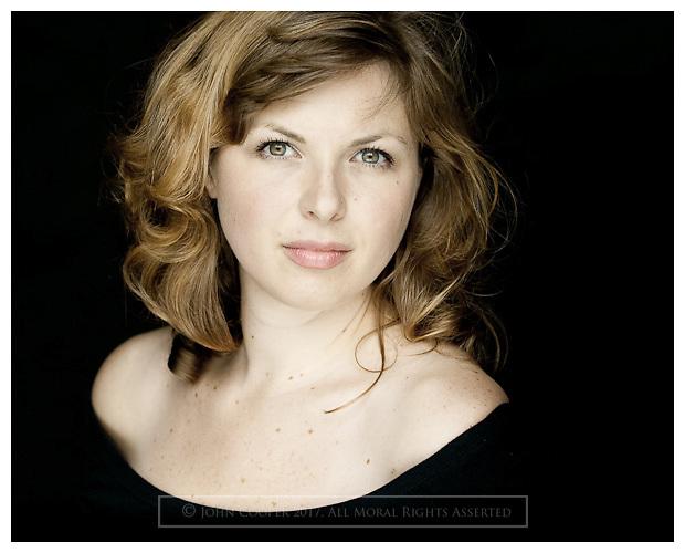 Headshot of actress Julia Taudevin.