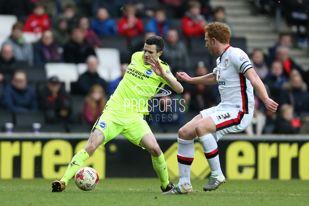Brighton winger, Jamie Murphy (15) and Milton Keynes Dons defender Dean Lewington (3) during the Sky Bet Championship match between Milton Keynes Dons and Brighton and Hove Albion at stadium:mk, Milton Keynes, England on 19 March 2016.