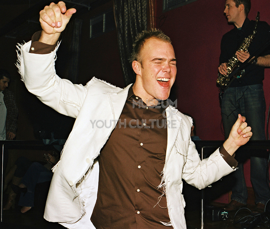 A man dancing with trendy ripped jacket at Funktup, December 2004