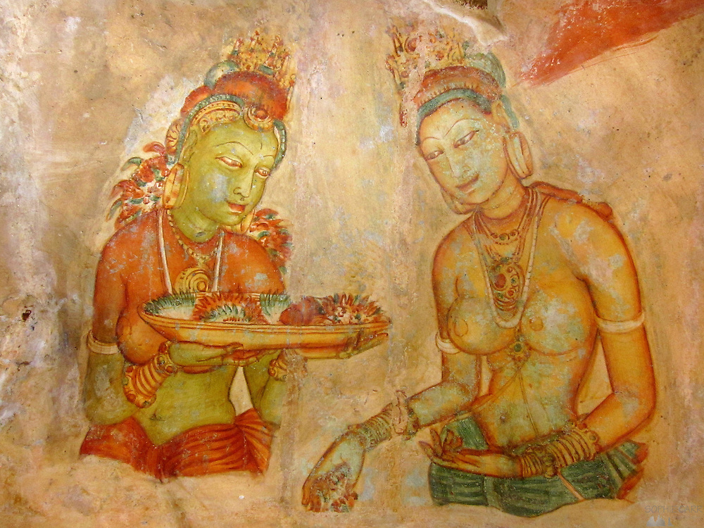 Paintings in a cave on the side of the big rock fortress at Sigiriya, Sri Lanka