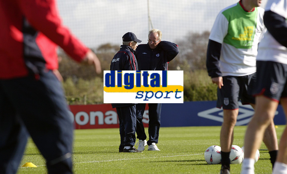 Englands coach Sven-Goran Eriksson chats with his assistant Tord Grip during training for the match against Wales<br /> <br /> Back Page Images - Mobile 07887 794393 - email: jgarcia@nildram.co.ukRY&A