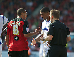 BOURNEMOUTH, ENGLAND - Saturday, April 9, 2011: Tranmere Rovers' Joss Labadie and Bournemouth's Anton Robinson are both are both asked to shake hands by the Referee during the Football League One match at the Dean Court Stadium. (Photo by Gareth Davies/Propaganda)
