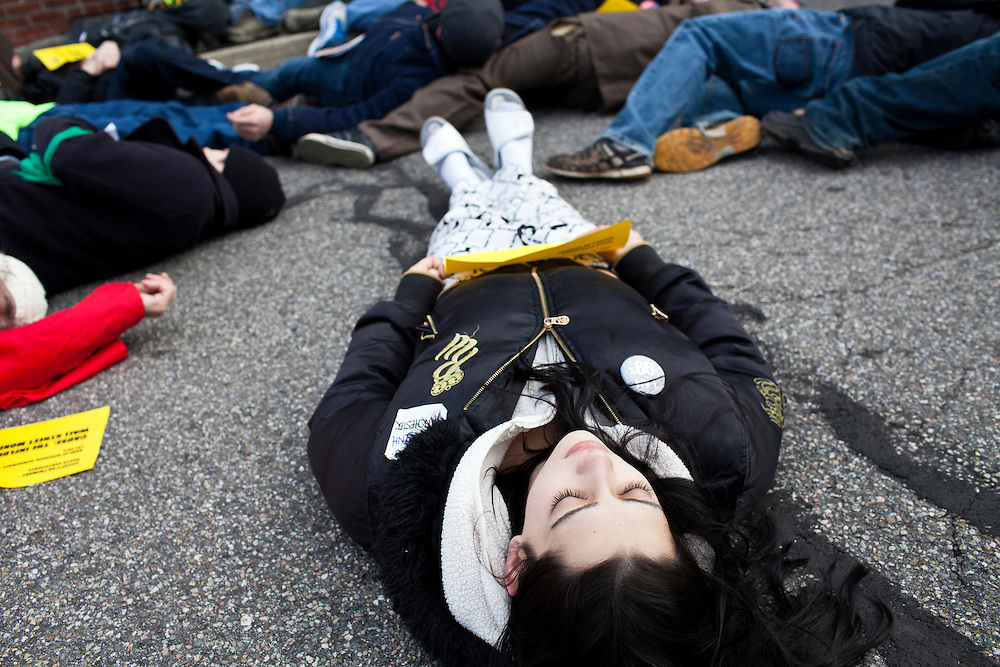 Emily Jehlicka and other Occupy protesters stage a die in at the offices of Organizing for America, President Obama's re-election organization, on Monday, January 9, 2012 in Manchester, NH. Brendan Hoffman for the New York Times