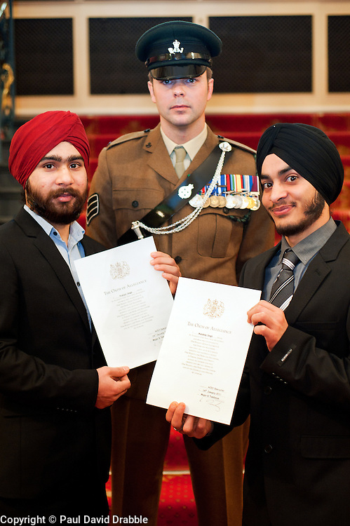 British Army Enlistments Oath of Allegiance held at the Mansion House Doncaster South Yorkshire. left to right recruits Parbjot Singh and Mandeep Singh with  Sjt David Hack of 3 Rifles of the ACIO (Army Careers Information Office) Doncaster ..14 January 2010.Images © Paul David Drabble
