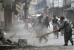 Chinese soldiers clear the debris from the earthquake in Lushan county of Ya'an, Sichuan Province, China, 21 April 2013. The Lushan Earthquake in Sichuan Province on 20 April 2013 resulted in 186 people dead, 21 missing, 11248 injured. About 1.72 million people were affected by the quake, while an initial estimate by the International Red Cross on Saturday put the number needing emergency shelter, water and food at 120,000. The China Earthquake Administration (CEA) recorded a magnitude 7.0 earthquake, while the US Geological Survey said it had measured 6.9.
