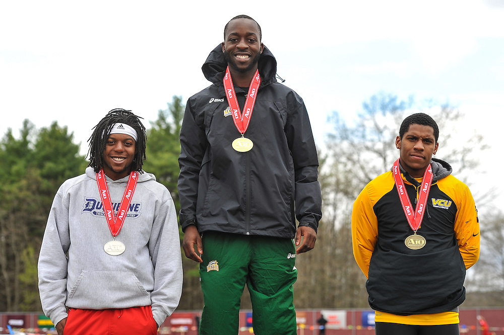 AMHERST, MA - MAY 4: Jimi Tele of George Mason University (205) stands atop the podium after winning the men's triple jump during Day 2 of the Atlantic 10 Outdoor Track and Field Championships at the University of Massachusetts Amherst Track and Field Complex on May 4, 2014 in Amherst, Massachusetts. Ian Welch of Duquesne University (79), left, was second, and Racheed Davis of Virginia Commonwealth University (526), right, was third. (Photo by Daniel Petty/Atlantic 10)