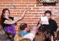 "Jene Rebbin Shaw (left) thanks an audience member who helped out during Mayhem & Mystery's production of ""Tragedy in the Theater"" at the Spaghetti Warehouse in downtown Dayton, Monday, February 28, 2011.  It's one of the reasons it's called interactive theatre."