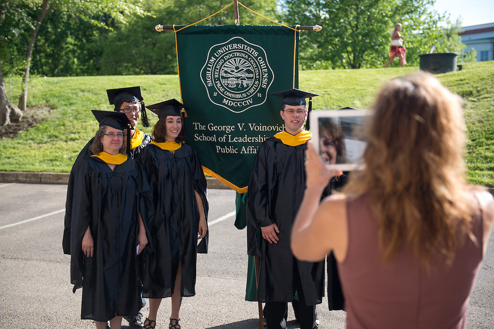 Students from the Voinovich School of Leadership and Public Affairs prior to graduate commencement exercises outside fo the Convocation Center on Firday May 3, 2013.