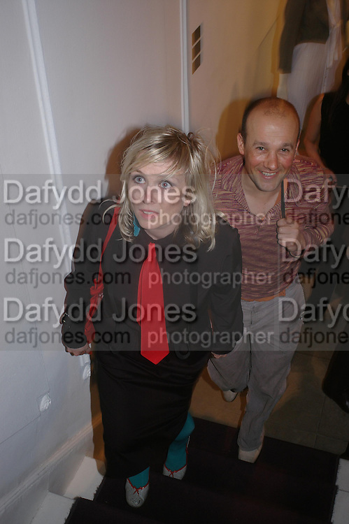 Georgina Starr and Paul Noble. Night at Crumbland to celebrate the launch of the Stella McCartney and Robert Crumb collaboration and the publication of the R.Crumb Handbook. Stella McCarttney shop. Bruton St. London. 17 March 2005. ONE TIME USE ONLY - DO NOT ARCHIVE  © Copyright Photograph by Dafydd Jones 66 Stockwell Park Rd. London SW9 0DA Tel 020 7733 0108 www.dafjones.com