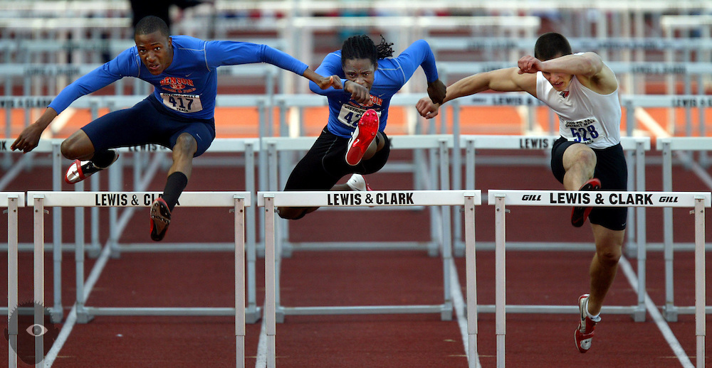05/14/2009 - Benson's Josh Hickman (417) clears the last hurdle as teammate Justin Johnson (420) stays close and Lincoln's Austin Cheadle (528) just behind during the men's 110 meter hurdles. The 6A PIL Varsity District Track Meet takes place at Lewis and Clark College....KEYWORDS:  City, Portland, sports, high school, state, boys, girls