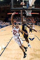 Virginia forward Mike Scott (32) shoots over Drexel center Frank Elegar (15).  The #23 Virginia Cavaliers men's basketball team defeated Drexel Dragons 72-58 at the John Paul Jones Arena in Charlottesville, VA on November 20, 2007.