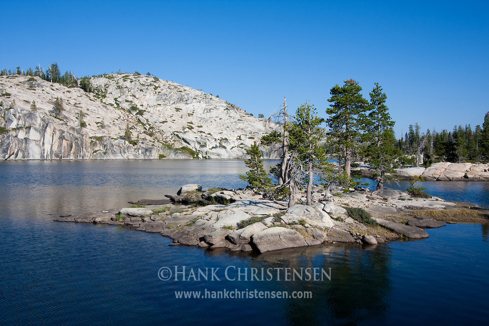 A small island sits at the edge of Boundary Lake, Yosemite National Park
