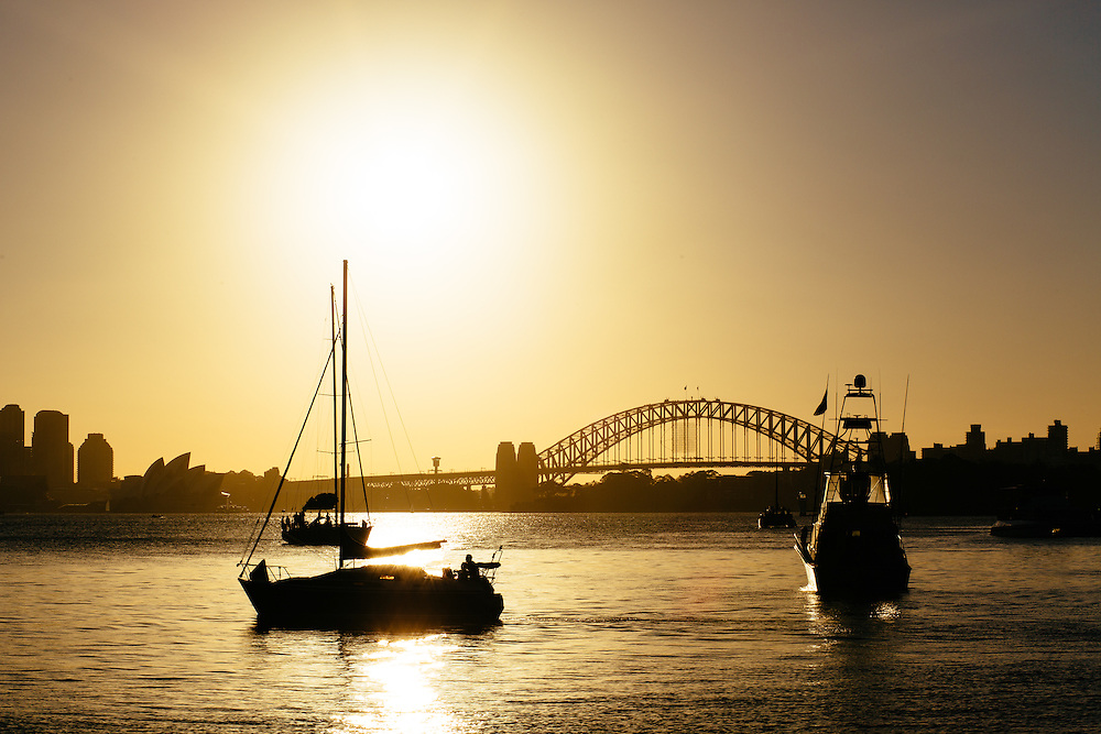 Silhouetted boats and city skyline of Sydney from Bradleys Head.