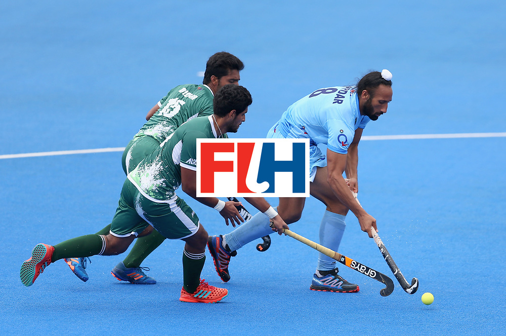 LONDON, ENGLAND - JUNE 24:  Sardar Singh of India breaks away from Muhammad Dilber of Pakistan and Muhammad Arslan Qadir of Pakistan during the 5th-8th place match between Pakistan and India on day eight of the Hero Hockey World League Semi-Final at Lee Valley Hockey and Tennis Centre on June 24, 2017 in London, England.  (Photo by Steve Bardens/Getty Images)