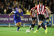 AFC Wimbledon striker Cody McDonald (10) battles for possession with Brentford defender Harlee Dean (6) during the EFL Cup match between AFC Wimbledon and Brentford at the Cherry Red Records Stadium, Kingston, England on 8 August 2017. Photo by Matthew Redman.