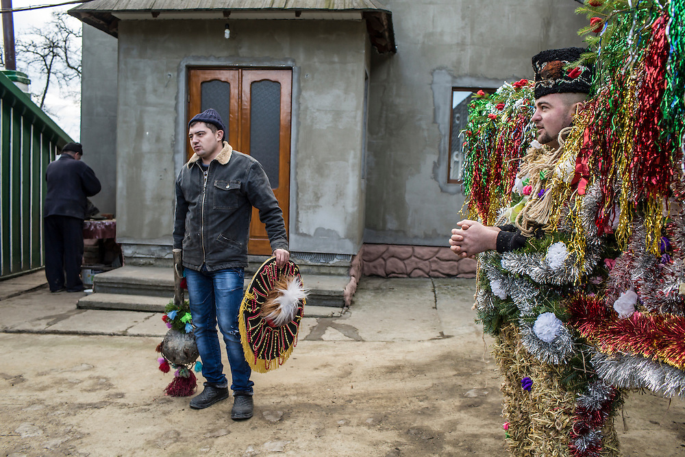 "Ivan Herman, 27, center, who will dress as a gypsy, and Stepan Savchuk, 26, at right, wearing an elaborate bear costume that will be worn as part of celebrations in the Trazhan district during the Malanka Festival on Wednesday, January 13, 2016 in Krasnoilsk, Ukraine. The festival begins at sundown and will last until the following evening. At rear is Mykola Savchuk, 48, father of Stepan. He says: ""We've had this tradition for a long time. In Soviet times, you could go to prison for celebrating Malanka. It was a big hazard, but we celebrated anyway."""